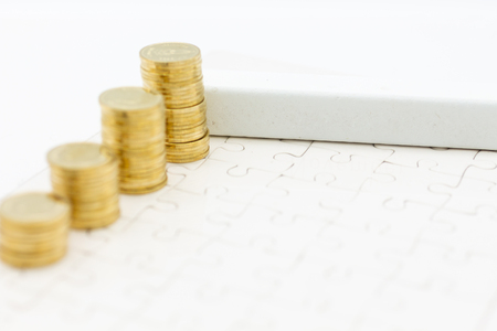 White block and stack of golden coins, it can write for various occasions. Image use for business background concept.