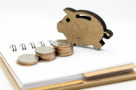 Piggy bank standing on stack of coins. Image use for investment, saving money.