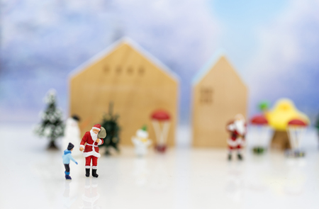 Miniature Santa Claus and children happy feeling on Christmas day, gift for everyone.