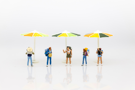 Miniature people : Traveler take a long vacation in tourism. Image use for spending time for holiday.