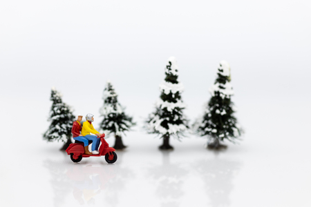 Miniature people :Traveler driving motorcycle in winter season. Image use for travel concept. Stock Photo