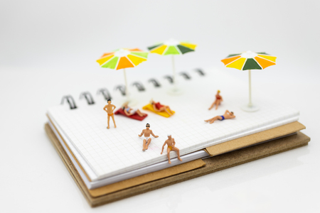 Miniature people : children in swimsuit and friends. Image use for holiday, vacation concept.