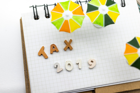 Wooden colorful text is TAX . Image use for Tax calculation every year for everyone.