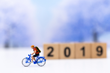 Miniature people : Travelers riding bicycle. Image use for background traveling and healthy, exercise concepts. Stock Photo