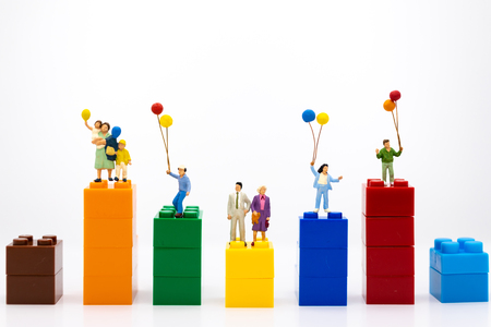 Miniature family: Childrens playing balloon together. Image use for background International day of families concept.