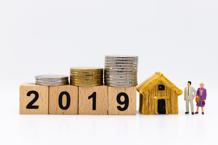 Stack of coins with wooden block 2019 for happy new year, image use for long-term investment for benefit, business concept.