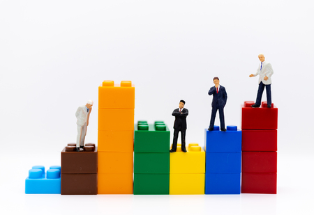 Miniature people: Businessman stand front of dashboard, display graphs, profit margins of  background. Image use for business concept.