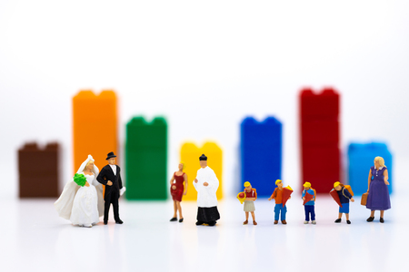 Miniature people : Bride and groom wear wedding suit and have a lot of people for congratulation. Image use for make new family.
