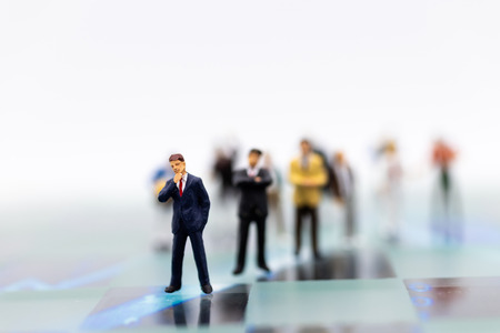 Miniature people: Group of businessmen work with team. Image use for background choice of the best suited employee, HR,job interview, job recruiter concepts. Stock Photo
