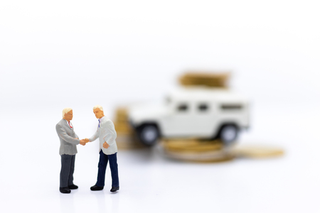 Miniature people : Businessman with stack of coins and car. Image use for financial , business concept.