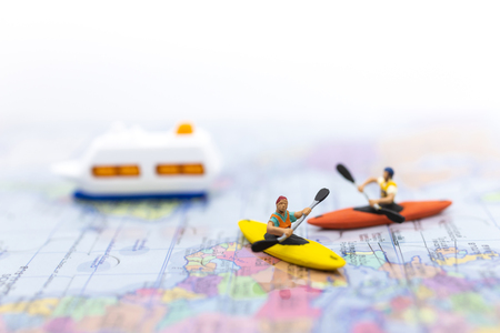 Miniature people : Travelers with paddle boat . Image use for activities, travel business concept. Stock Photo