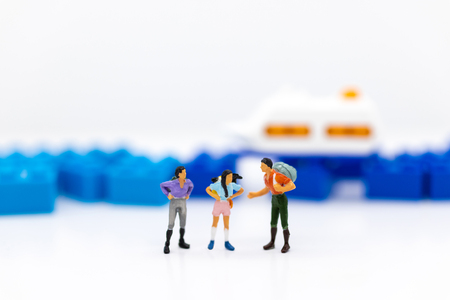 Miniature people: passenger waiting vehicle for go to destination, transportation. Image use for business background concept.