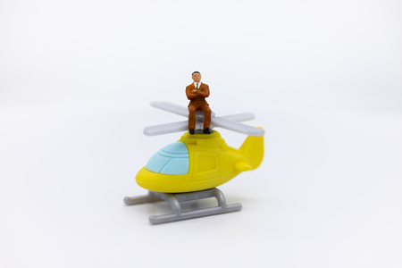 Miniature people: Businessman traveling by plane. Image use for travel, business concept.