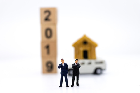 miniature people: Business consultants on financial transactions for home loan . Image use for financial, business concept.