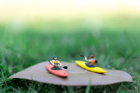 Miniature people : Traveler boating, kayaking in the ocean. Image use for Sports and Tourism concept.