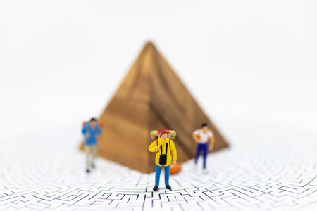 Miniature people: Tourists walk on the maze map, with a graph showing the top.Image use for tourism campaign, spending money, holiday concept.