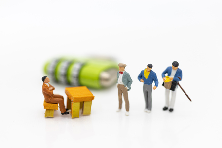 Miniature people:  Businessman sitting on master key encoding. Image use for background security system, hack, business concept. Stock fotó
