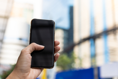 Hand holding smartphone, image use for mobile applications and multimedia programs. Stock Photo