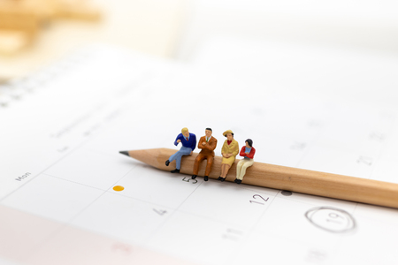 Miniature people : Group business sitting on the pencil. Image use for education, business concept.