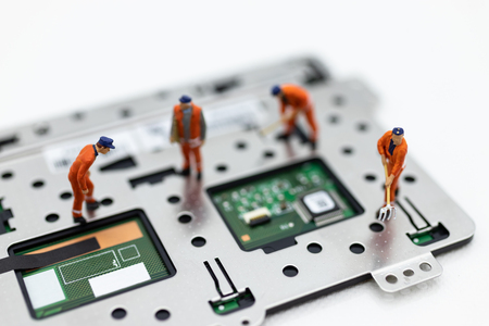 Miniature people: Workers repairing circuit board ,electronics repair. Use image for support and maintenance business.