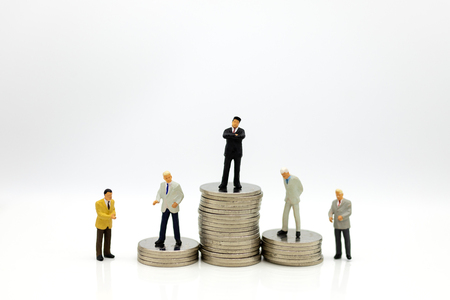Miniature people : Businessman standing on stack of coins. Image use for business concept. Stock Photo