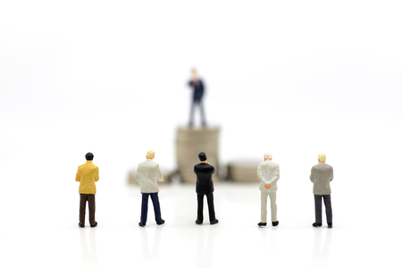 Miniature people : Businessman standing front of stack of coin. Image use for financial, business vision concept.