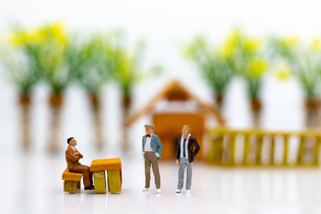 Miniature people: Businessmen work with team, using as background Choice of the best suited employee, HR, HRM, HRD, job recruiter concepts.