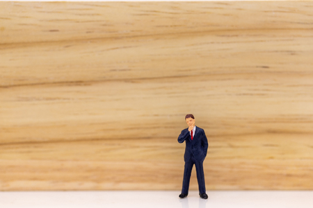 Miniature people: Businessman stand with think space area. Image use for business concept, new idea. Stock Photo