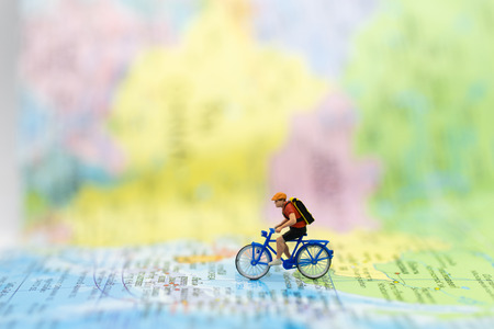 Miniature people : traveler walking on the map Thai language. Used to travel to destinations on travel business background concept.