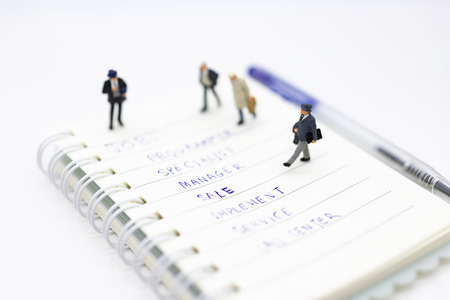 Miniature people: Supervisors look for employees for job placement, using as background Choice of the best suited employee, HR, HRM, HRD, job recruiter concepts. Stock Photo