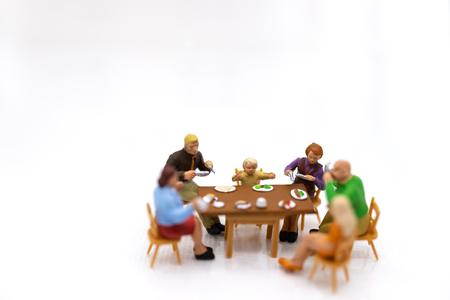 Miniature people:  Families are celebrating , eating together happily. Image use for the concept of family festival.