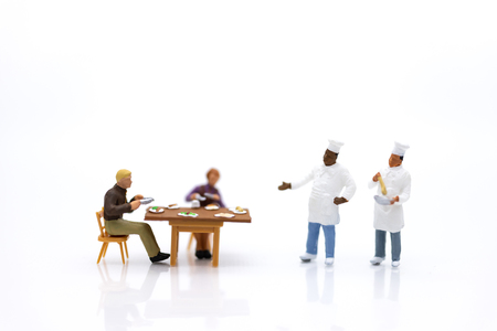 Miniature people: Chefs are cooking for customers who are waiting for service. Image use for quick service, food and beverage, business concept.