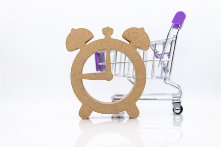 Shopping cart and wooden watch ,image use for discount period for shopping ,special price, sold out, business marketing concept