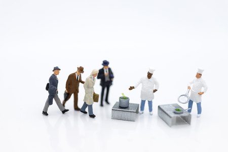 Miniature people : Chefs are preparing food for sale. Image use for  food and beverage, business concept.