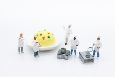 Miniature people : Chefs are preparing food for cook in kitchen. Image use for new menu creation, food and beverage concept.