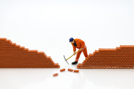 Miniature people: Workers are digging walls, using images for destruction, hacking, network security, business concept.