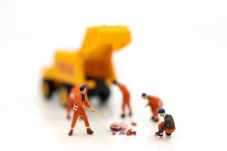 Miniature people : Workers are cleaning, area for construction work. Use images for construction business. Stok Fotoğraf