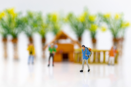 Miniature people: Group travelers travel by plane go to the beach. Image use for travel vacation, business concept.