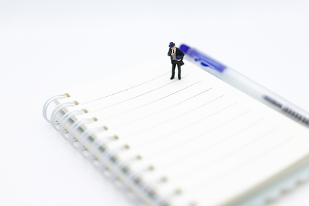 Miniature people standing on the book using as background education or business concept. Stok Fotoğraf