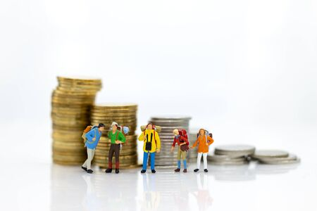 Miniature people : Tourist group go to travel the places and have expenses for tourism. Image use for travel business