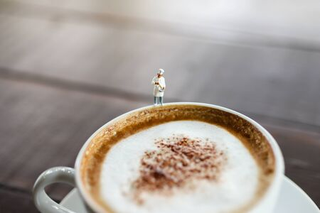Miniature people : Coffee cup with barista, image use for charge your energy in the morning Stock Photo