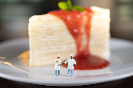 Miniature people : Cake with chef, image use for bakery special day