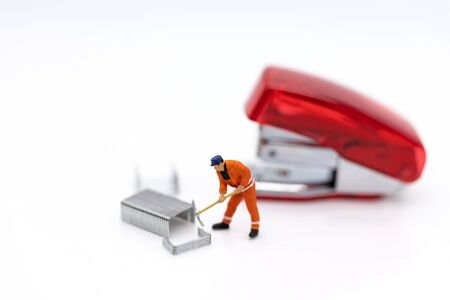 Miniature people : Employee with stapler, image use for office equipment
