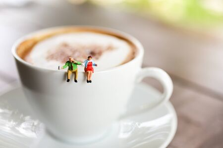 Miniature people : Coffee cup with businessman , image use for charge your energy in the morning Stock Photo