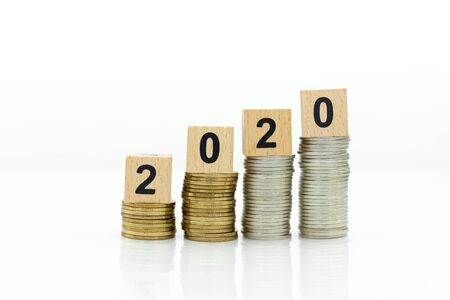Happy new year ,wooden block 2020 wiht coin.  Image use for beginning new thing, business concept.