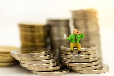 Miniature people: Meaty man sitting on top of stack coins using as background retirement planning, Life insurance concept.