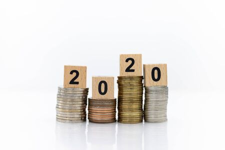 Wooden blocks 2020, placed on stack coins, Image use for business concept, new year