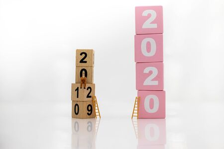 Miniature people : Starting from the old year to the new year, Image use for the new beginning of life, business concept