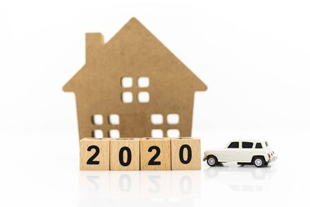 Wooden home with car, block 2020. Image use for background money, financial, insurance concept. Stock Photo