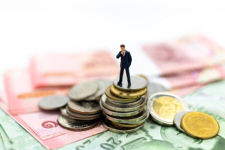 Miniature people : Businessman with money, The rhythm of market share contention, image use for risk, money, business concept